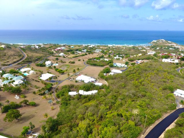 Arial view of lot, majestic ocean & high end homes within Judith's Fancy's top of the line neighborhood