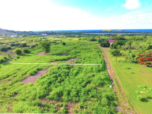Estimated lot boundary. Flat, easy build, with gorgeous sea views. Green Cay to the North of Lot.