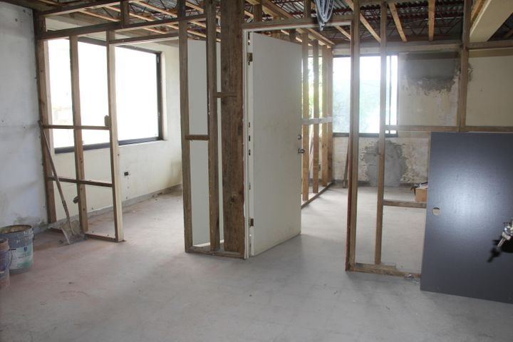 Suite 203 is divided with with small offices or it can be opened into 1 large room
