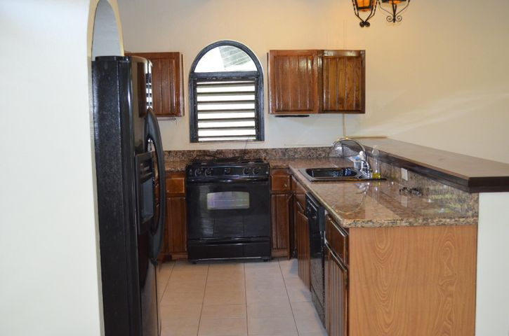 Granite counters and bar styled-seating, gas range and dishwasher