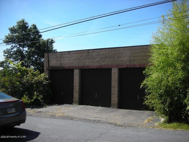 Garage For Sale- 29' x 32' concrete block garage located on Boone Court in Hazleton. Features 3  overhead garage doors and bays that are large enough for vehicles plus additional storage. Roof coated in 2018. Ideal for your ''toys'' or as a rental property!