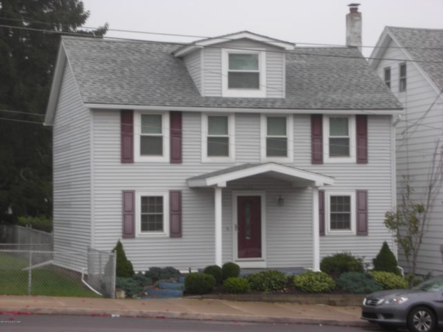 Broad Street Single- this renovated home is in ''like new'' condition. Features a modern kitchen with appliances,  3 bedrooms, large bathroom, finished attic, gas heat, recessed ceiling lighting and fireplace. Includes a newer detached one car garage, adjacent 32'x150 'fenced-in'' lot, covered deck, landscaped yard, fireplace and much more! Close to hospital and downtown conveniences.