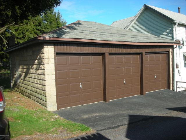 Garage For Sale- 3 stall garage centrally located in Hazleton. Measures ~24' x 25' with individual partitioned stalls. The partition walls can be readily removed to create a large open garage. Ideal for vehicle storage or as a rental property. Also has a small rear yard that can be used for gardening or other private use.