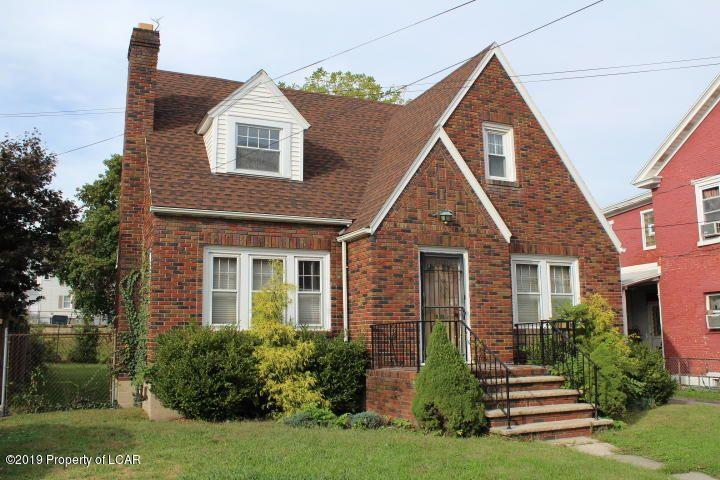 Tamaqua Cape Cod-  this charming brick home offers a modern kitchen with breakfast nook, first floor bedroom with adjoining bathroom, spacious living room with hardwood floors and fireplace, a formal dining room, two additional bedrooms and a full bath on the second floor. Also, replacement windows, re-shingled roof, large yard and detached two car garage. Located near downtown conveniences!