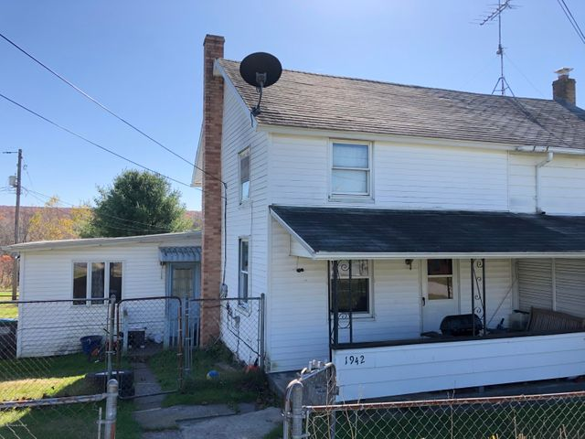 Hazle Township Half Double- Offering three bedrooms...  one on the first floor, so no steps! Also, bathroom, laundry, family room, dining room,  and eat-in kitchen. Plenty of  off street parking in front. Large yard too. Great rental or your new home.  Check out the newly reduced price!
