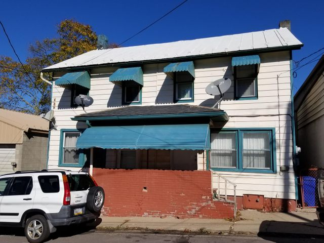 Hazleton double house, fully rented, and ready for a new owner! 2 bedrooms in each side. Replacement windows, remodeled bathrooms and remodeled kitchens. Tenants pay electric, heat, and hot water costs.