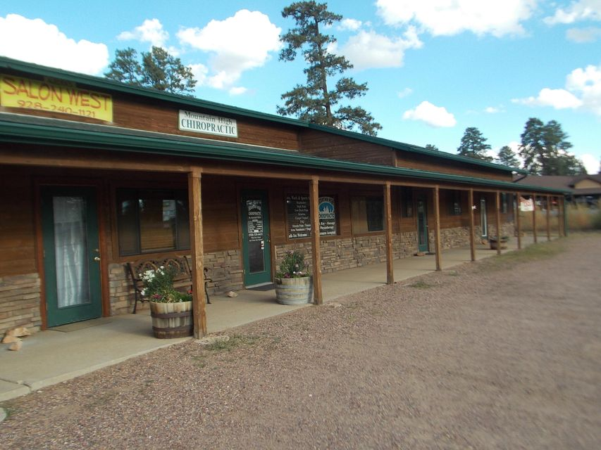 Commercial investment property in the heart of Heber-Overgaard, located across from National Bank and True Value Hardware!!! Over 4000 sq' building with five units of which two are currently rented.  Building with full length covered front and lots of parking.  Plenty of highway frontage!!
