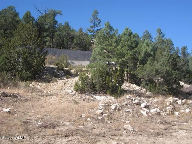 Gorgeous hillside parcel offering great views of Black Canyon and close to USFS boundary. Approximately 1300 sq.ft stem wall for two level home already completed with retaining wall to rear of foundation and 3 bedroom septic installed. Approximately 1.34 acres with paved access and water and electric available. Seller may carry or look at financing options with licensed contractor for construction loan.  Great investment opportunity. Seller is a licensed Arizona real estate agent.