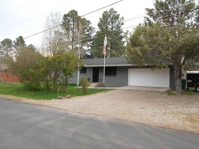 Stunning 3 Bedroom 2 Bathroom Completely Remodeled Home in the Heart of Show Low.