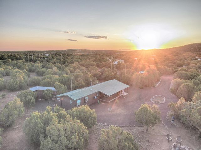 Aerial front view of home at sunrise.