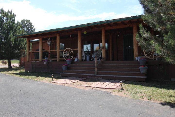 Front of the home with large covered deck