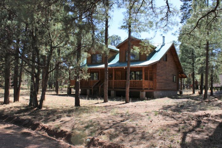 Log Cabin with 4 Bedrooms 2 bath and a beautiful .25 acre lot awaits it new owners!
