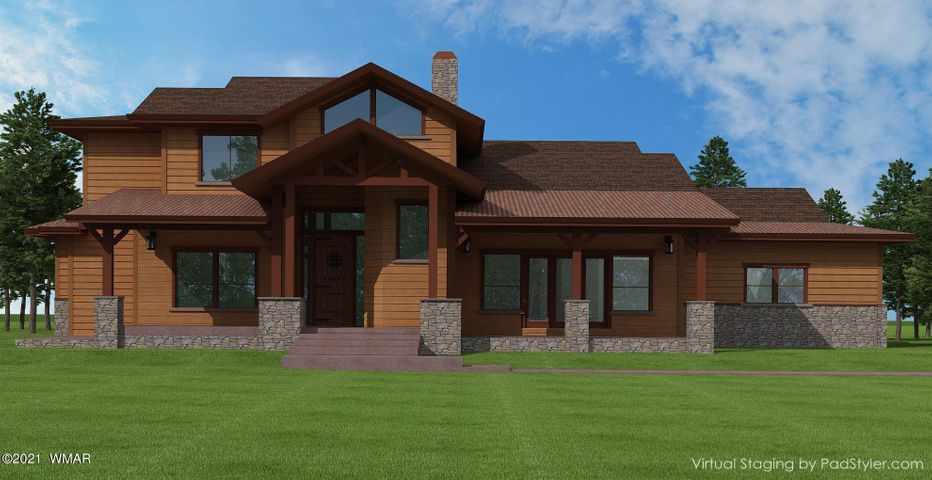 New custom home backing National Forest. This beautiful luxury cabin where you can sit on your front deck  and enjoy lake views in the front while nothing by National Forest views in the back!  This mountain retreat home features, vaulted ceilings, loft, large open kitchen and greatroom to gather all of your family and friends around, Wood flooring, solid wood doors, quartz, granite, travertine, 2 furnaces, 2 tankless/ on demand water heaters, large stone fireplace, anderson windows  and all of the many amenties you would expect  in a luxury home.  Approved set of HOA plans for a 3351 square foot home with a 3 car garage.  Still time to pick your own interior colors! Floor plan and renderings available to preview. Sierra Springs ranch a gated community with lakes, streams, walking paths, fishing, kayaking and many trails to explore right outside the gates. 76 acres completly surrounded by National Forest. 2 private fresh water wells with the best tasting water in Arizona.  Pinetop Arizona your  premier Mountain paradise with the largest standing Pondersoa Pines in the country! Arizona's best kept secret!