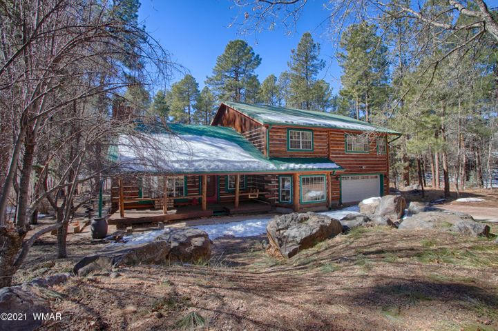 Talk about LOCATION! This home not only backs to Billy Creek but is also located at the end of a cul-de-sac and in downtown Lakeside! This home gives you a true feeling of being in the middle of the woods while also minutes away from all amenities. Half of the home is a true log home (locally milled logs) and the other half has been added on to with matching half log siding. Special features include: sun/AZ room, a potential 4th bedroom, all windows have gorgeous views of nature & wildlife, beautiful rock & antique barn wood fireplace wall in the living room with a pellet stove & grill, large family room with custom wood shelf inserts, all three bedrooms have vaulted T&G ceiling, and a loft. The master bedroom has an insert for a potential gas fireplace, large walk in closet, (continued) office/nursery room with a built in sink and nicely sized master bathroom with a luxurious walk in shower. The oversized back porch is surrounded by trees and shrubs which encompasses you into a private oasis with peaceful sounds from the creek. There is a hiking trail that runs on the other side of Billy Creek from the house and National Forest is only a few minutes away!  This is the perfect White Mountain retreat and/or full time cabin.  Call today for more information and to set up a private showing.  Sunrise Ski Resort is only 20 minutes away where you can enjoy skiing, snowboarding and sledding on the three different mountains available with the highest peak at 11,000 elevation and 62 different runs.  During summer they offer archery shoots, the largest zip lining course in the state of AZ, hiking and biking.  This home is also very close to more than 34 lakes and reservoirs and over 320 miles of beautiful streams and rivers which consists of many different species of fish.  Perfect for fishing, fly fishing, boating and sightseeing.  There are more than 180 miles of hiking trails within the region.  Most trails were once old logging roads between eight and 16 miles in length a