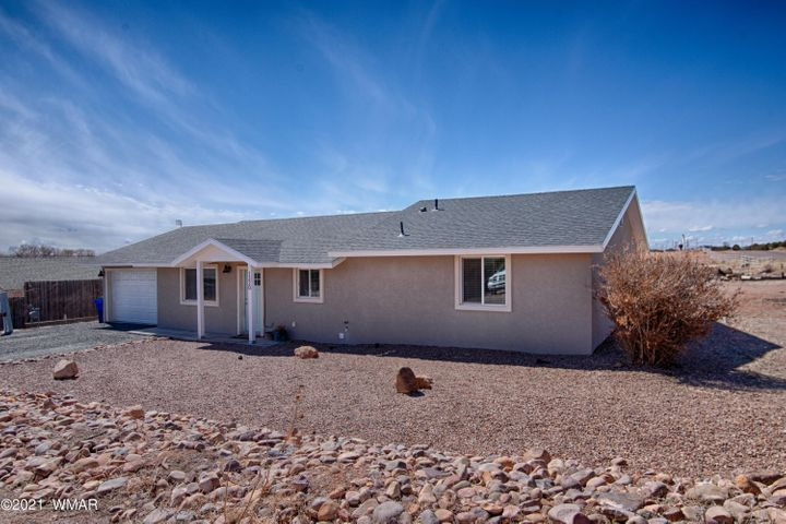 Here is your chance at a beautiful 4 bedroom, 2.5 bathroom, 2,050 square foot home and on 0.45 acres centrally located in Snowflake!  This home was completely remodeled in 2018; with a new roof, new exterior & interior paint, new plumbing & electrical, new kitchen & bathroom cabinets, counter tops, stainless steel appliances and the list goes on.  Other special features include a massive laundry room, large master bedroom with his & hers closets, lots of cabinet space in the kitchen, large backyard with grass area, wooden shed and a nicely landscaped from yard.  Call today to set up an appointment and make this house your home!