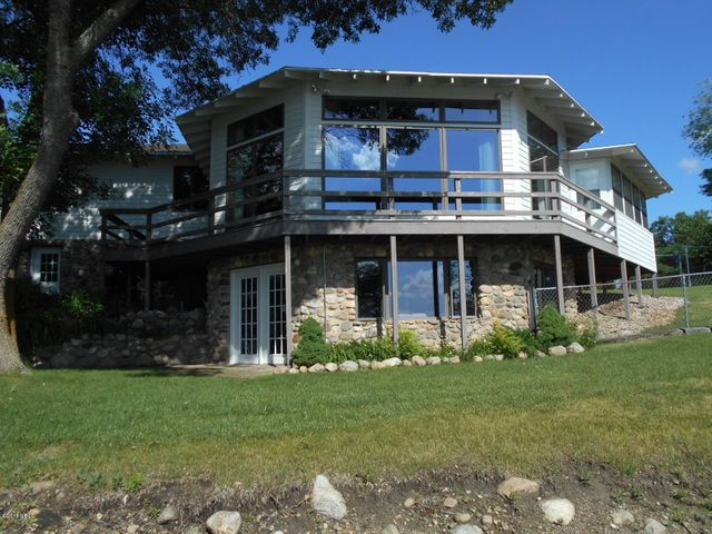 This truly one of a kind property on Lake Kampeska has total privacy on 2 lots with 210' of lake frontage.  The extra lot could be sold by new owners. Must see this spectacular home with unmatched views, lots of room for living and entertaining, open floor plan, stone fireplace in LR, new cabinets and Granite in kitchen, walk-out basement.